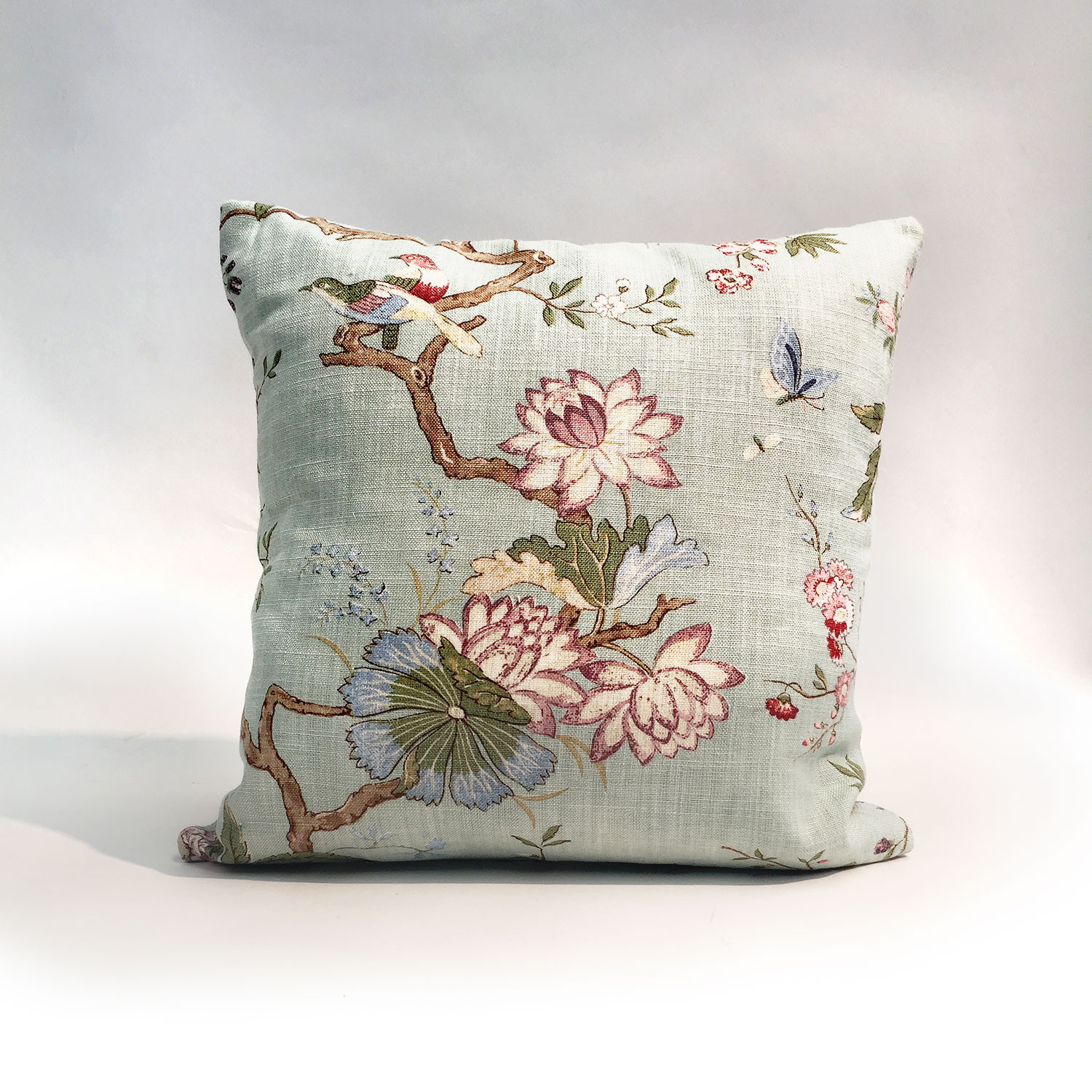 Cushion with motif of flowers, birds, butterflies