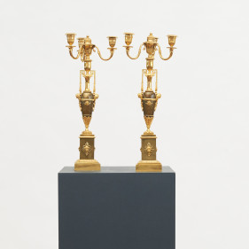 Pair of French empire candelabra of gilt and patinated bronze