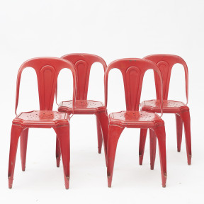 A set of 4 Red Metal Tolix Chairs. Design by Xavier Pauchard