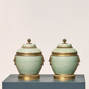 Pair of French cachepots and covers. Chinese Celadon porcelain with gilded bronze fitting